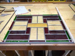 Glas in lood raam opbouwen voor isolatie